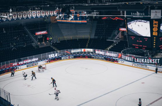 Hockey rink with Wisehockey's shot speed stats on LED screens