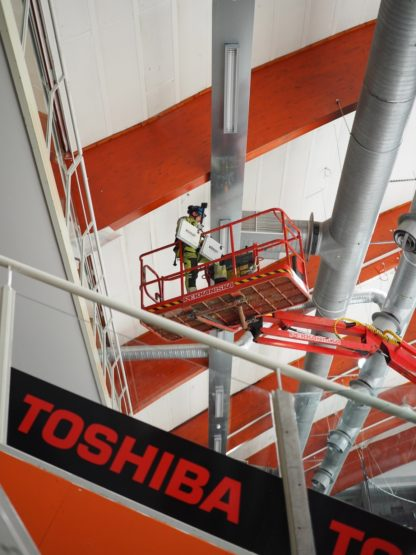 Installing locators to ceiling structures